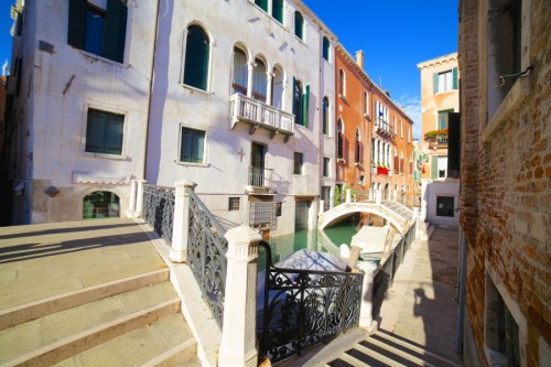 Beautiful romantic Venetian scenery. Street, canal, bridge. Venice. Italy