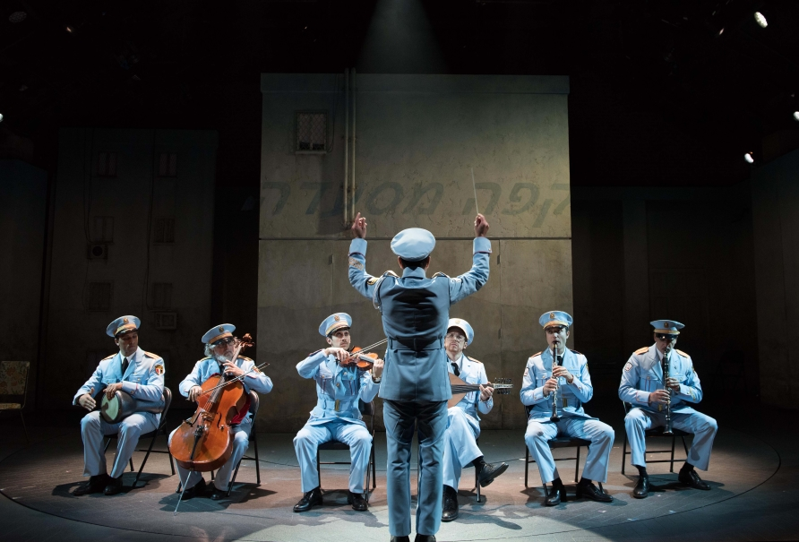 (l-r) Ari'el Stachel, David Garo Yellin, George Abud, Tony Shalhoub, Harvey Valdes, Sam Sadigursky, Alok Tewari in Atlantic Theater Company's world premiere musical The Band's Visit, directed by David Cromer, featuring a book by Itamar Moses and original score by David Yazbek. Opening December 8, 2016 at The Linda Gross Theater (336 West 20 Street). Photo: Ahron R. Foster.