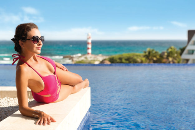 Hyatt-Ziva-Cancun-Rooftop-Pool-Girl-Pink-Bathing-Suit
